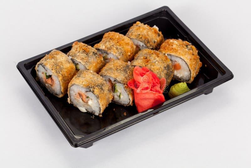 Japansk nationell populär kokkonst Sushi, ris och fisk Smakligt tjänade som beautifully mat i en restaurang, kafé arkivfoto
