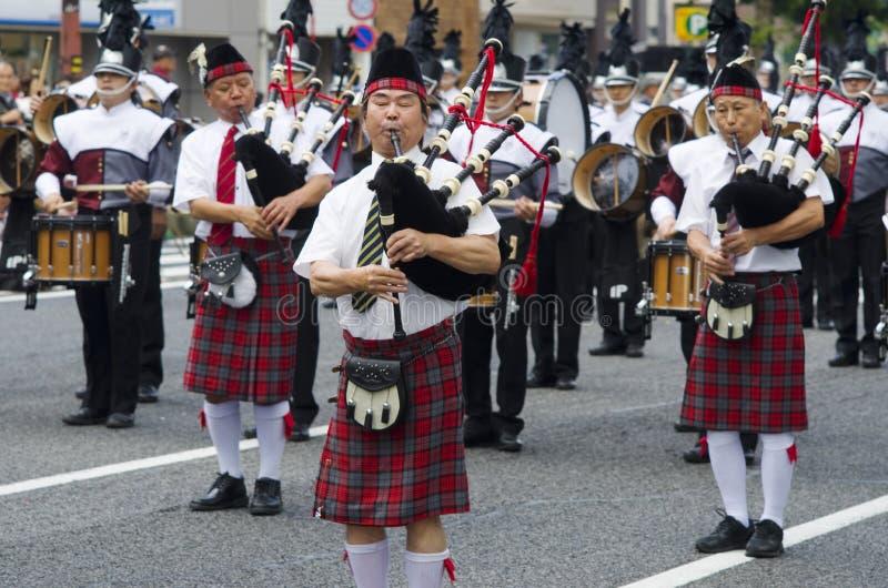Japansk säckpipe- musikband royaltyfri fotografi