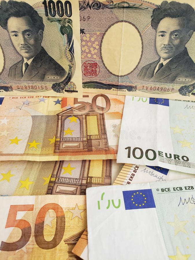 Japońscy banknoty i euro rachunki obraz royalty free