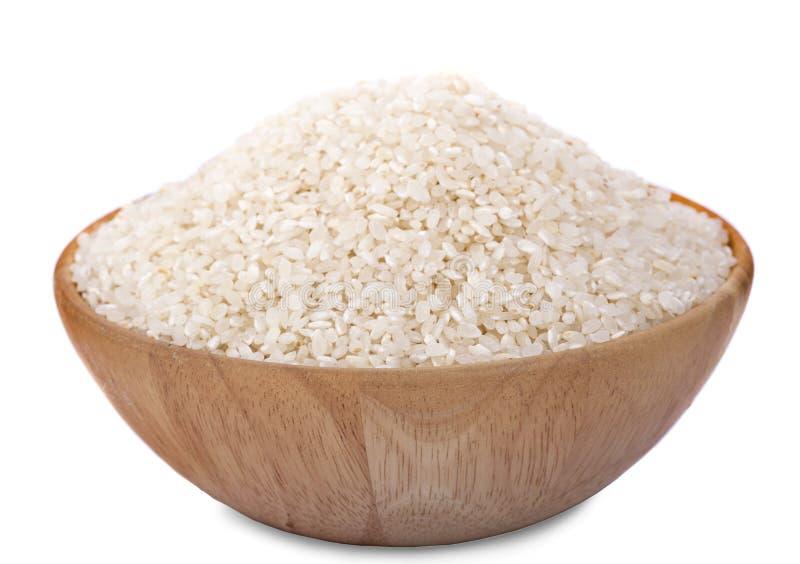 Japońscy ryż w drewnianym na białym tle obrazy royalty free