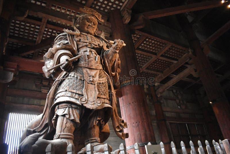 Japońska wojownik postać Ochrania Buddha fotografia royalty free