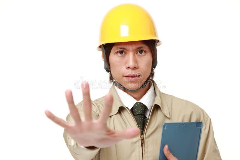 Japoński pracownik budowlany robi przerwie gestykulować zdjęcia royalty free