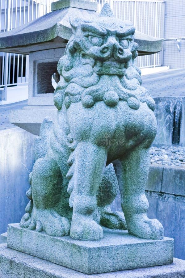 Japoński zwierzęcy bestia szczeniaka pies jednakowy lew i pies obrazy stock