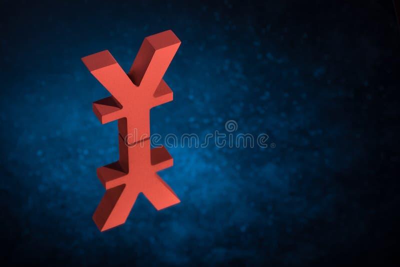 Japonés rojo del símbolo o de la muestra chino de moneda con la reflexión de espejo en Dusty Background azul imagenes de archivo