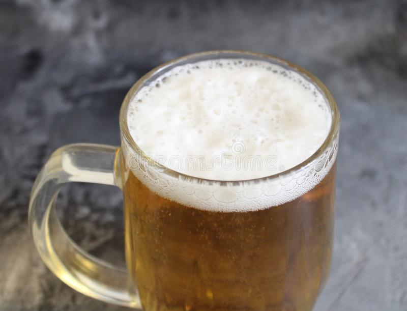 A jar of beer. On marble background stock images