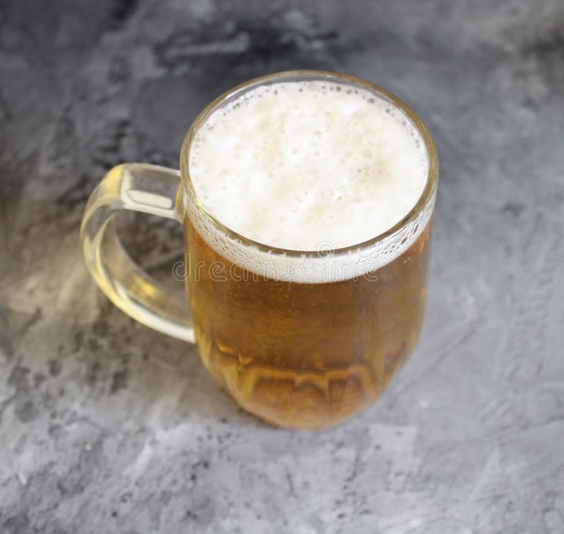 A jar of beer. On marble background royalty free stock image