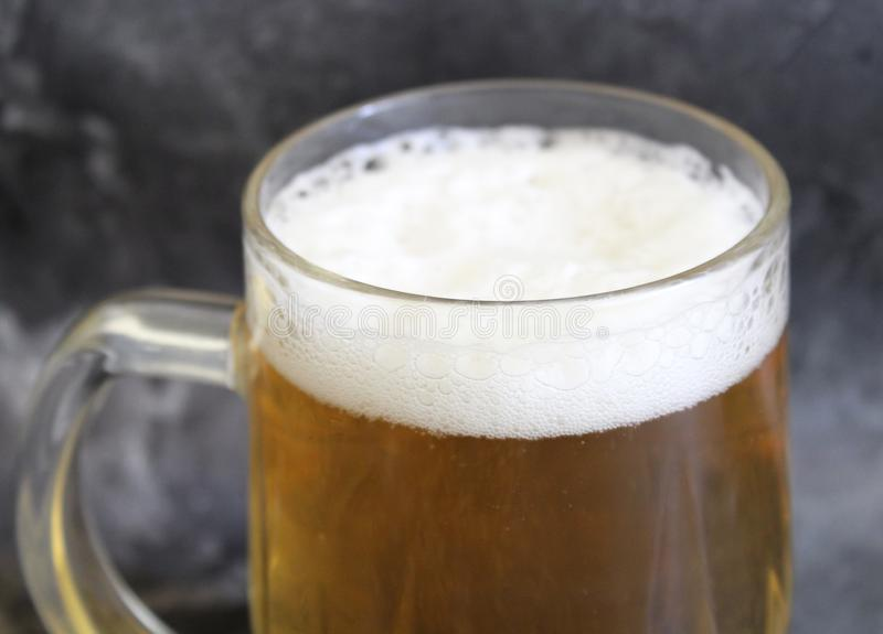 A jar of beer. On marble background stock photography