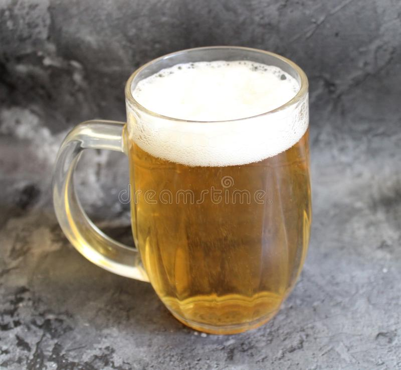A jar of beer. On marble background royalty free stock photo