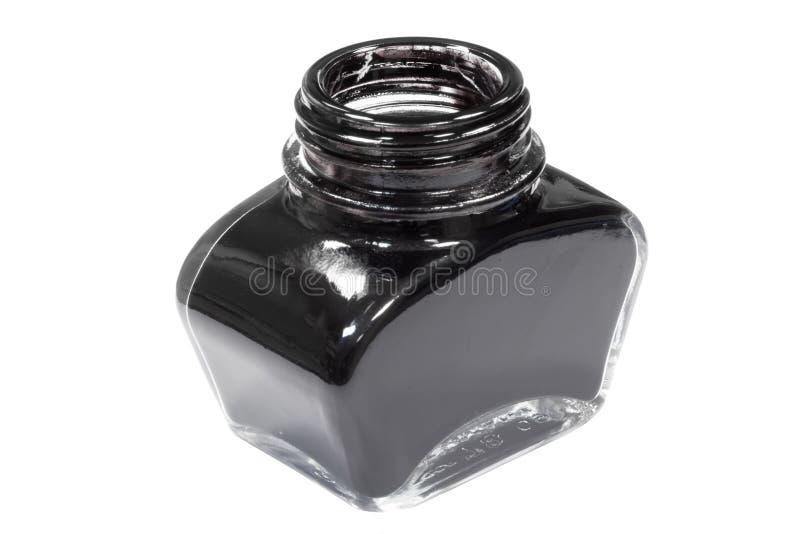 Jar of black ink stock photos