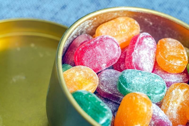 A jar of bright candy. The joy of children, a lot of sweets. Candy assorted colors. Caramel in powdered sugar. royalty free stock photos