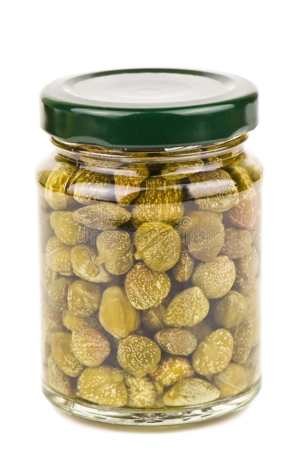 Jar of capers. On white stock photography