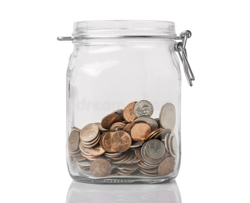 Jar of Change. A jar with american change used for savings or tips, isolated on white with reflection royalty free stock photo