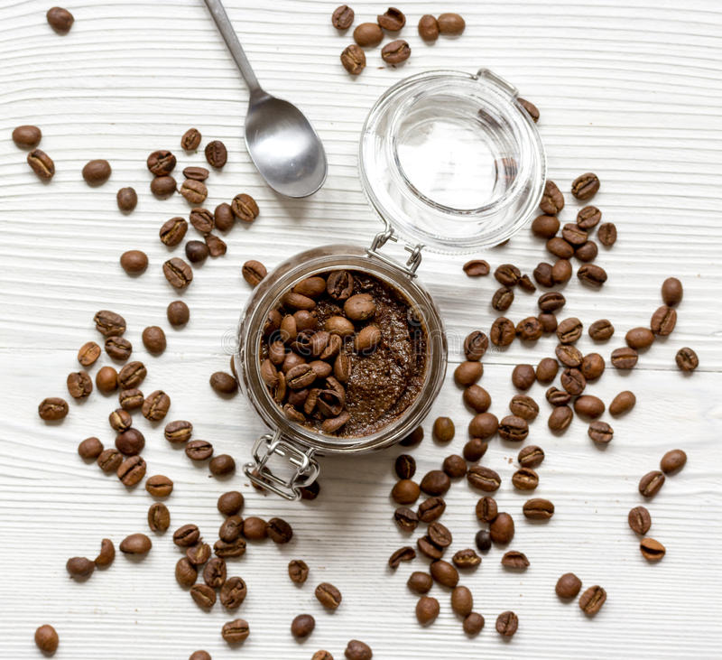 Jar coffee-chocolate scrub top view on wooden table.  royalty free stock photos