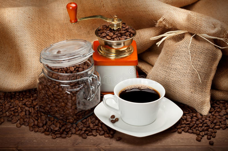 Jar of coffee and cup of espresso. Jar of coffee and cup of black espresso stock photo