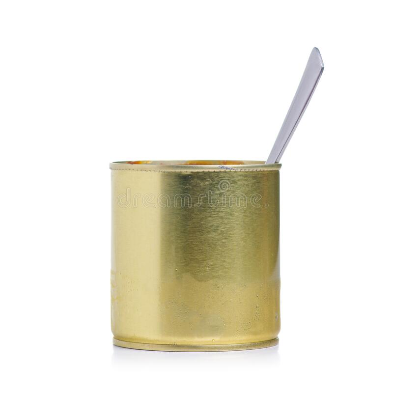 Jar with condensed milk with spoon. On white background isolation stock image