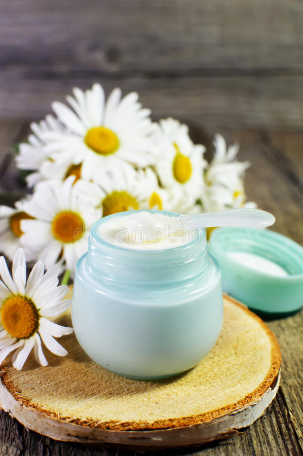 Jar with cosmetic cream on a wooden surface. royalty free stock photography