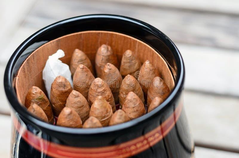 A jar of Cuban pyramid cigars stock images