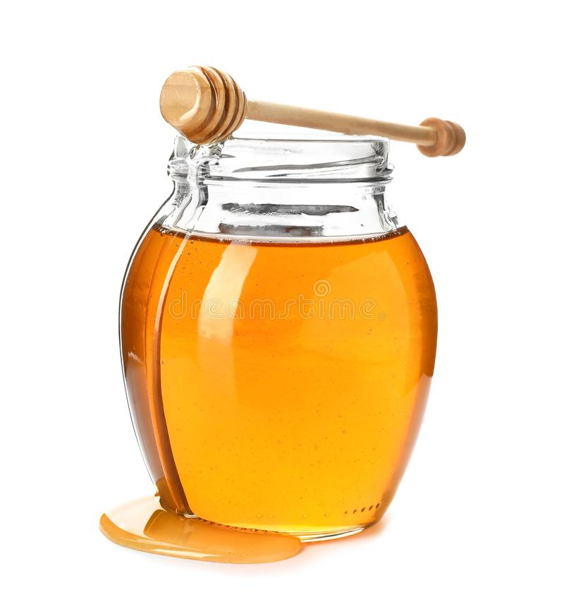 Jar with delicious honey and dipper stock photos