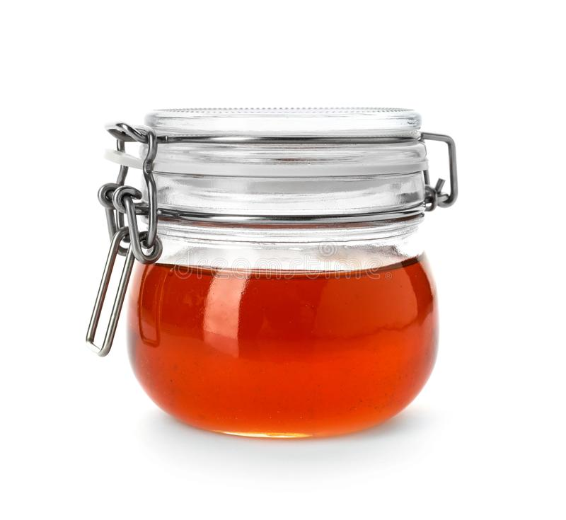 Jar with delicious honey. On white background stock photo