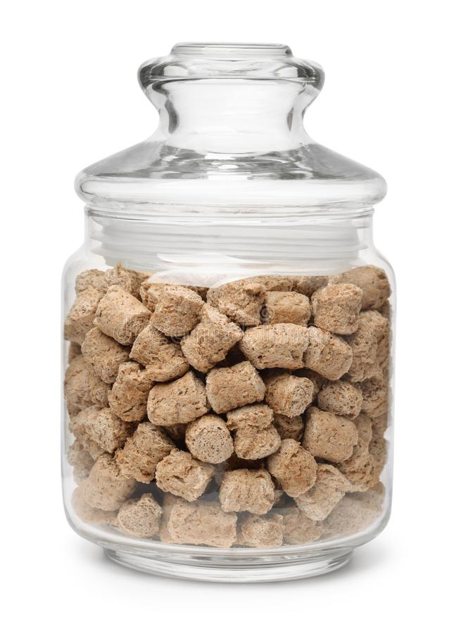 Jar of extruded oats bran pellets stock photo