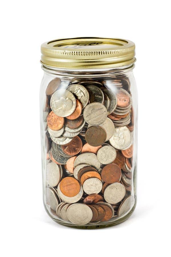 Jar Full Of Change On White Background. A full mason jar of change on a white background royalty free stock photos