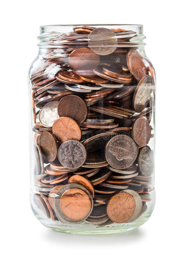 Jar full of coins royalty free stock images