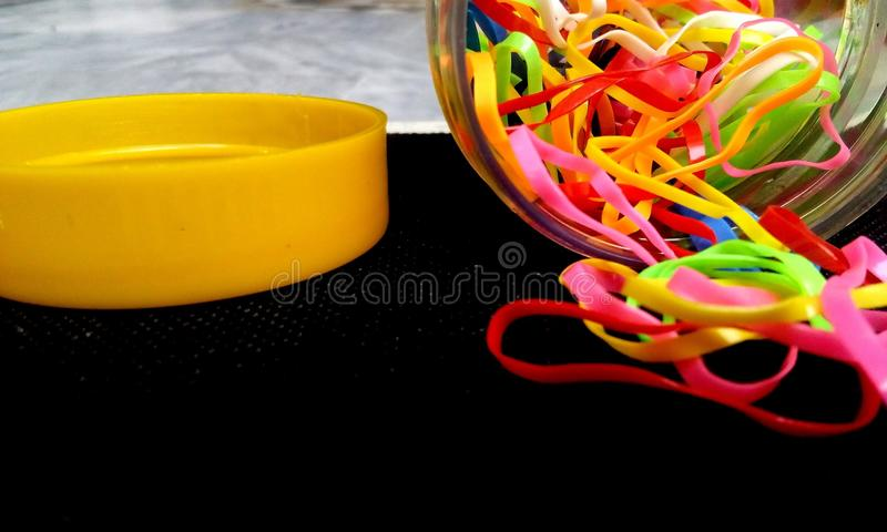 Jar full of colorful ruuber-bands. stock photos
