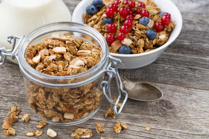 Jar with homemade granola, milk and fresh berries, top view. Horizontal stock photos