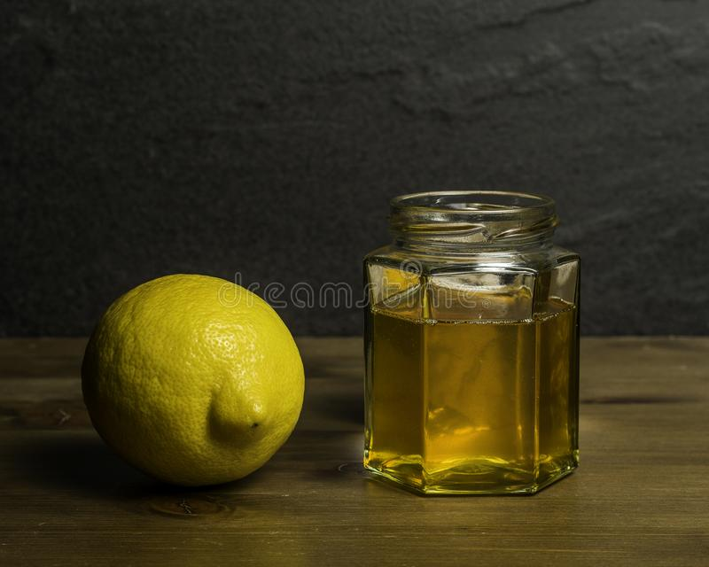 A Jar of homemade honey and Lemon cold remedy. A Jar of Homemade Honey and Lemon cold or flu natural remedy/cure stock photography