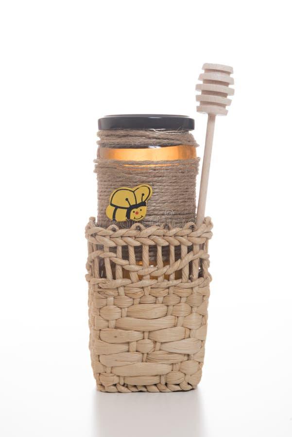 Jar of honey in a basket stock images