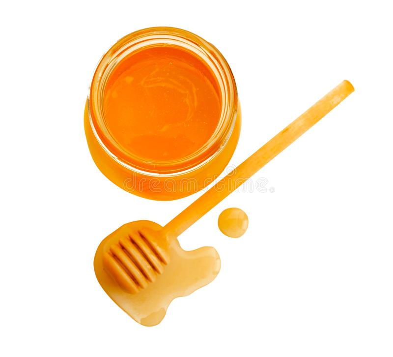 Jar of honey with dipper, isolated. On white royalty free stock photo