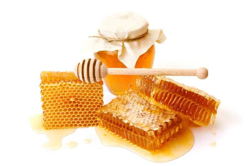 Jar of honey with honeycombs royalty free stock images