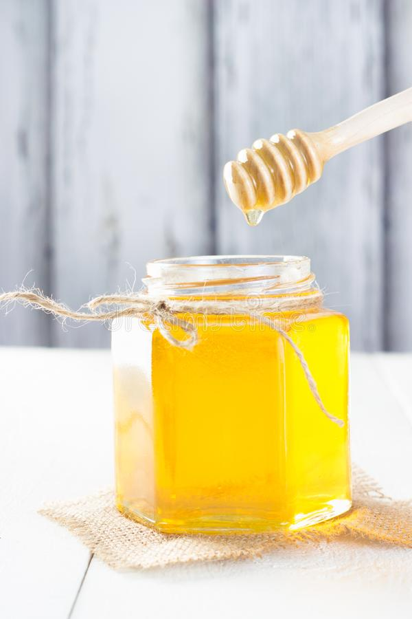 Jar of honey. On wooden table stock image