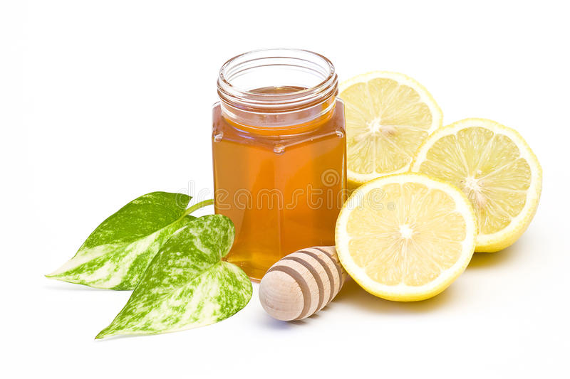 Download Jar Of Honey, Lemon And Wooden Drizzler Stock Photo - Image: 12620572