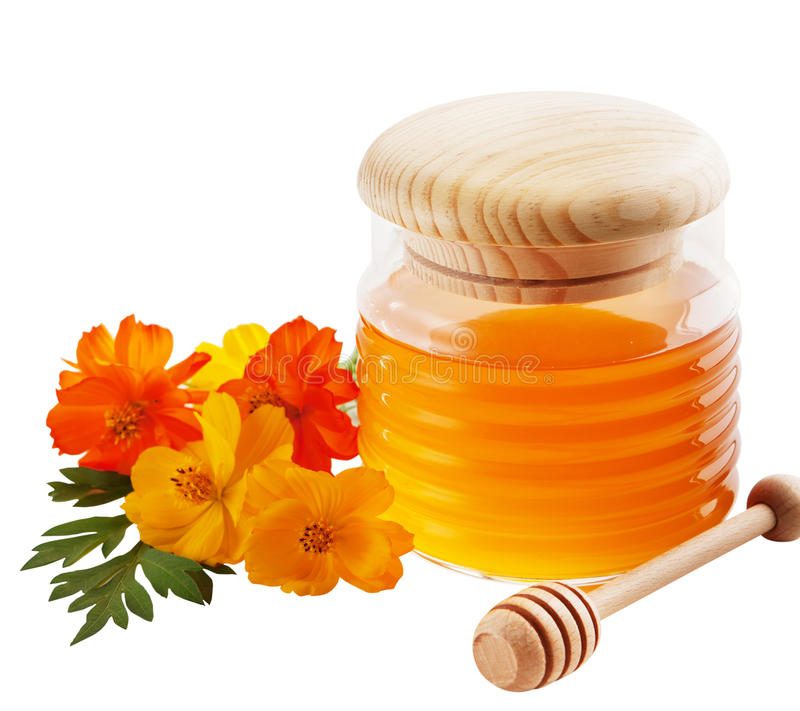 Jar of honey. And wooden wand isolated on white background royalty free stock photo