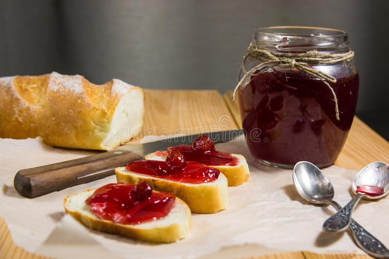 Jar of jam and toasts royalty free stock images