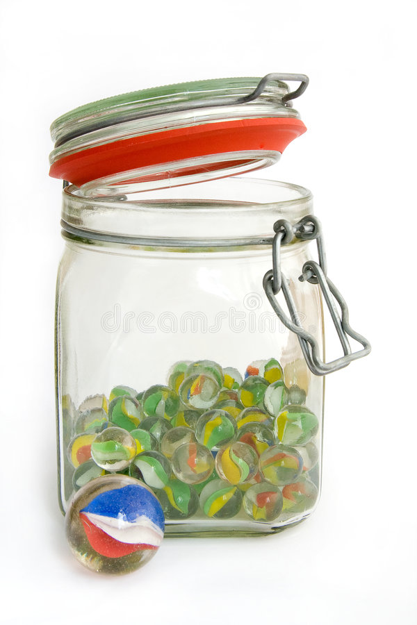 Jar of marbles stock photography