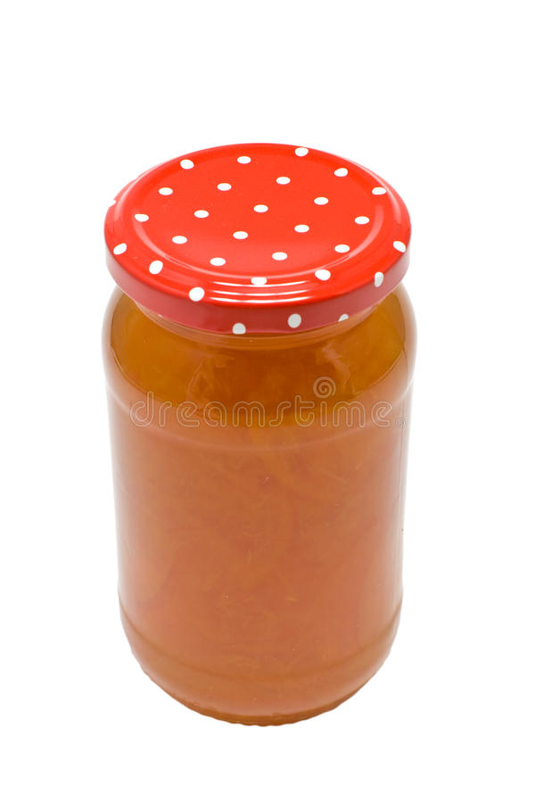 Jar of Marmalade. A jar of homemade seville orange marmalade isolated on a white background royalty free stock images