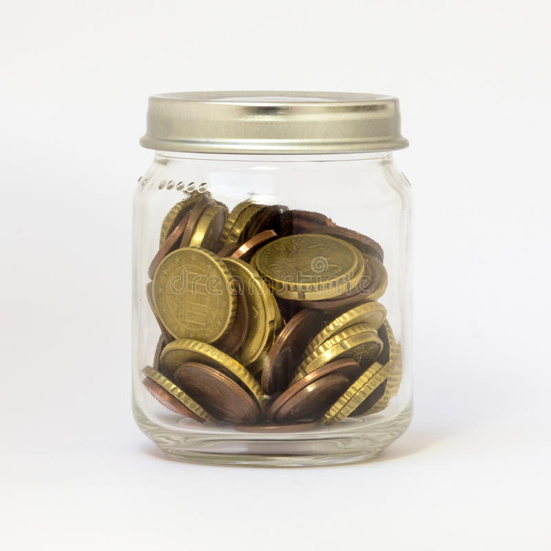 Glass Jar with Saving Money Coins Small Change. A glass jar, isoleted on white, containing loose change money (euro coin), with breading, closed. Almost like a stock photo