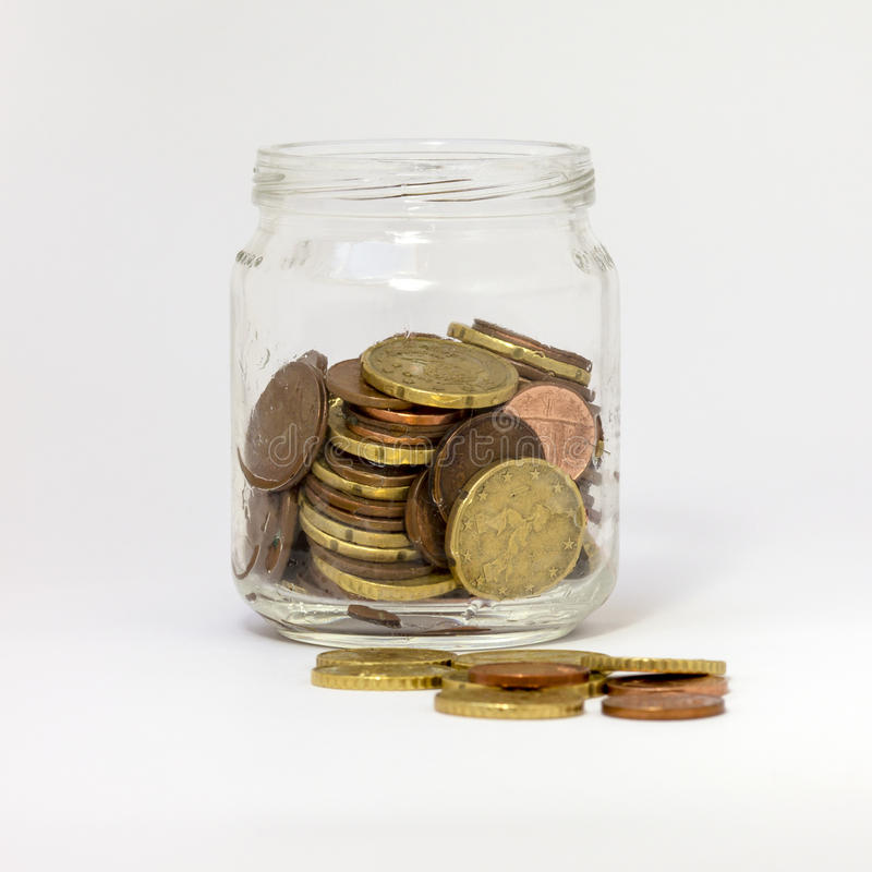 Jar with Money Small Change. A glass jar, isoleted on white, containing loose change money (euro coin), with breading, open. Almost like a piggy bank royalty free stock image