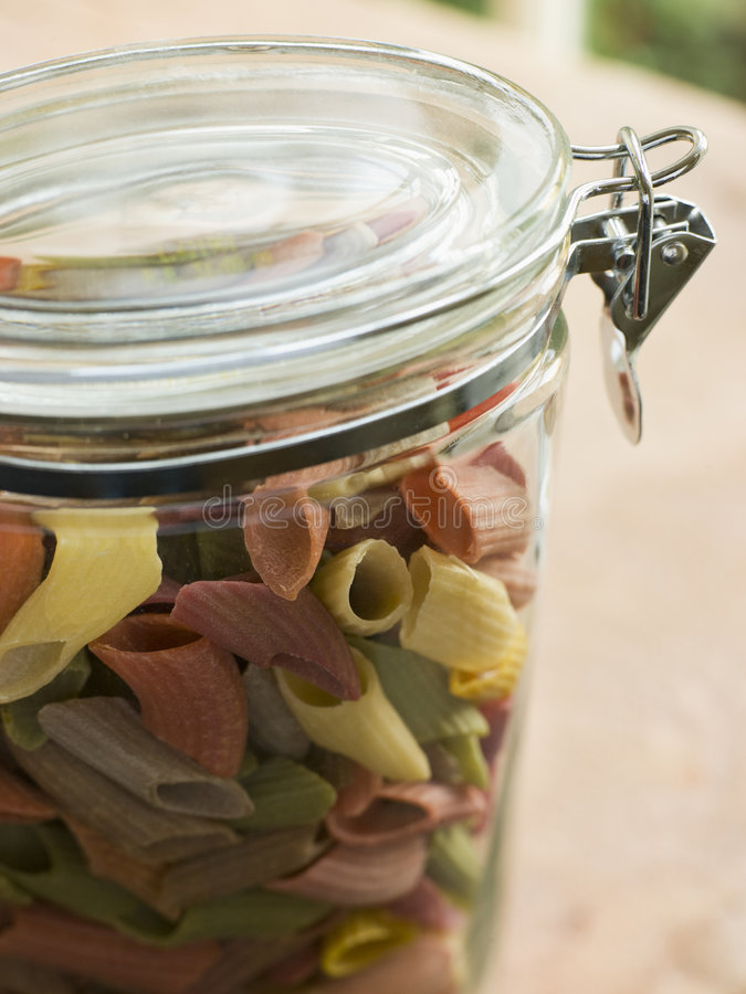 Jar Of Multi-Coloured Pasta. Close Up Of Jar Of Multi-Coloured Pasta royalty free stock photography