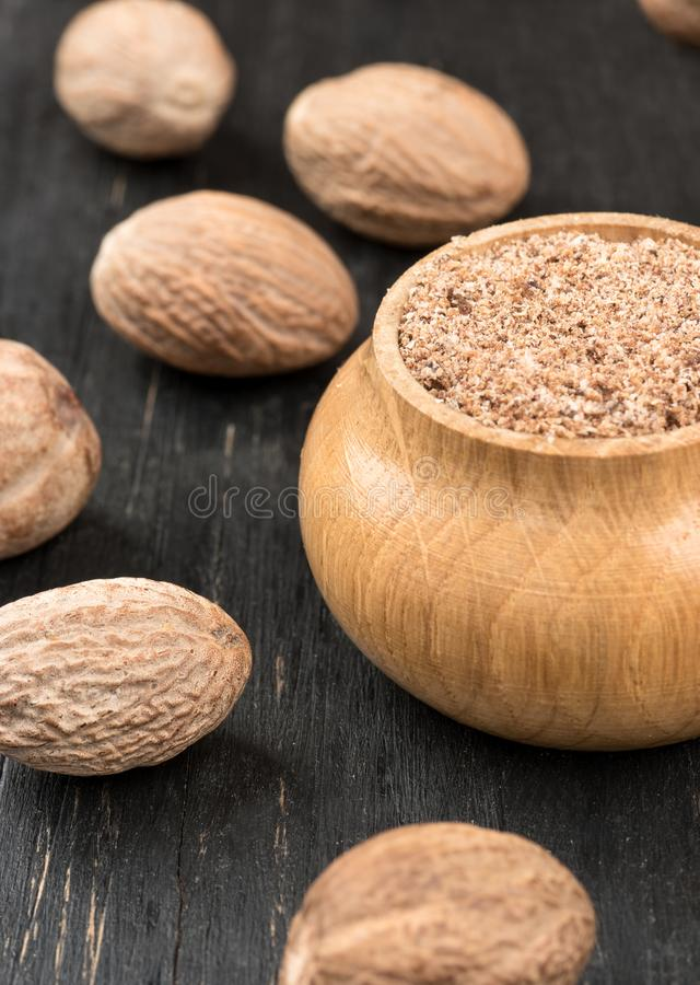 Jar with nutmeg powder stock image