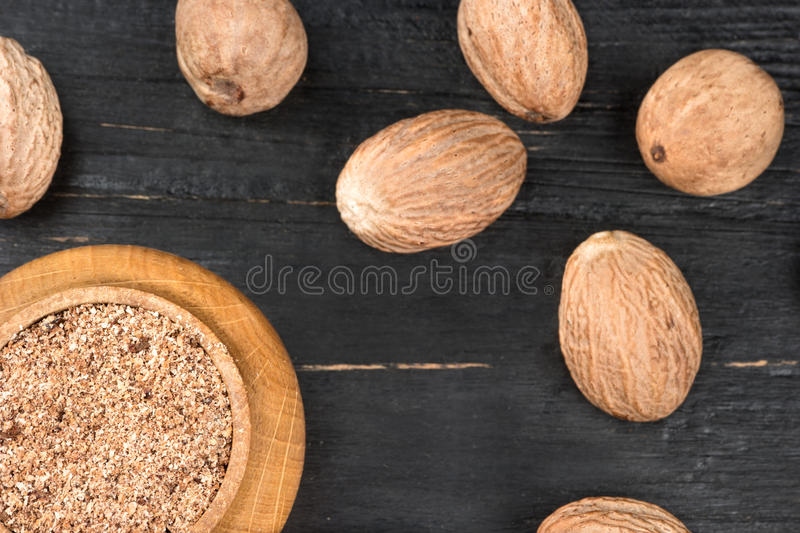 Jar with nutmeg powder stock photo