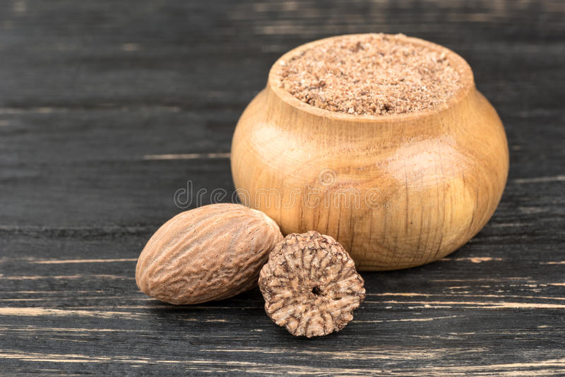 Jar with nutmeg powder royalty free stock photography