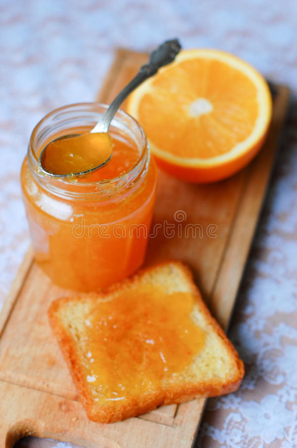 Free Jar Of Orange Marmalade And Toast With Orange Stock Images - 11716914