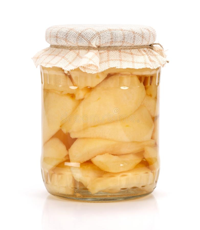 Pear compote. A jar of pear compote on white background stock photo