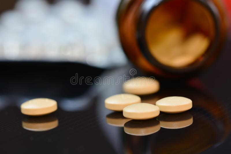 Jar with pills. On a dark background royalty free stock photos