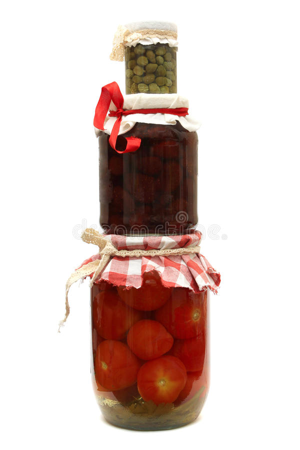 Jar with preserve. Jam, pickled tomatoes and capers isolated on white background royalty free stock photography