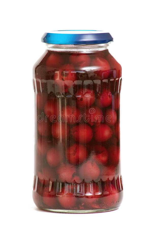 Jar with preserved cherries royalty free stock photos