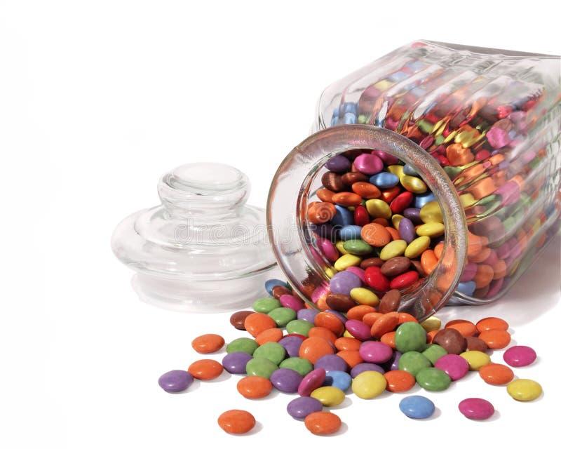 jar som spiller ut söta sötsaker royaltyfri bild
